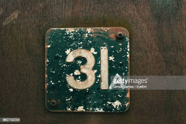 Close-Up Of Number On Wooden Door