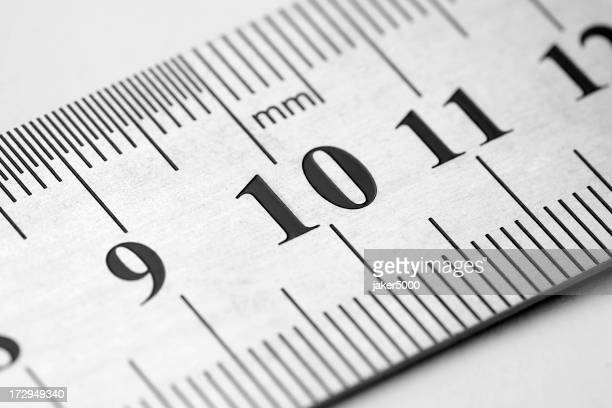 Close-up of numbers 9, 10, and 11, on a white metric ruler