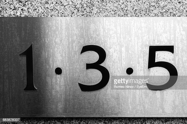 close-up of numbers mounted on wall - number 3 stock pictures, royalty-free photos & images