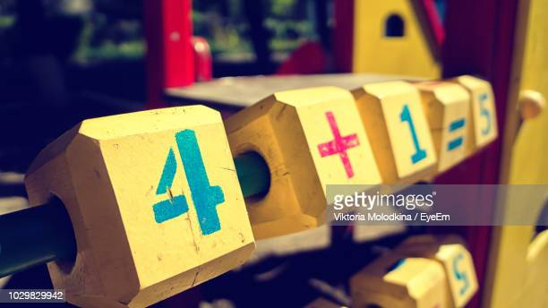 Close-Up Of Numbers On Yellow Play Equipment At Playground