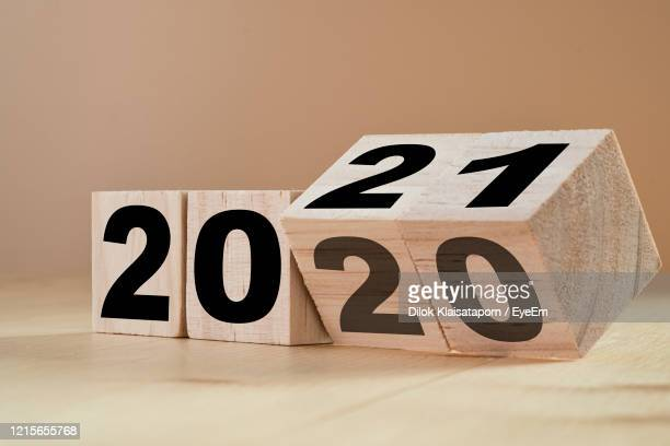 close-up of numbers over toy blocks on table - 2021 stock pictures, royalty-free photos & images