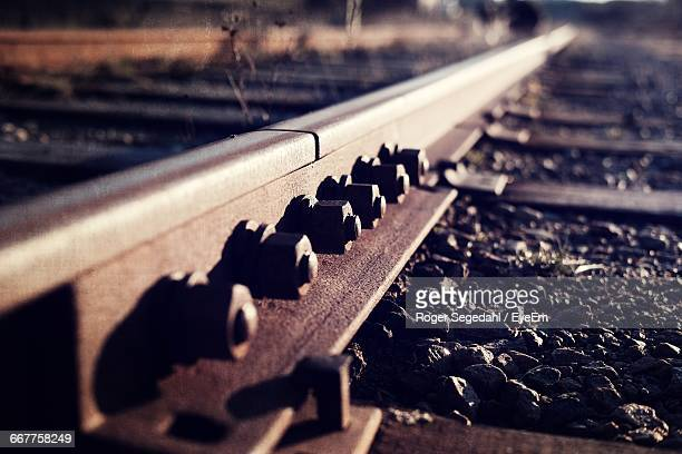 close-up of nut and bolts on rusty railroad track - railroad track stock pictures, royalty-free photos & images