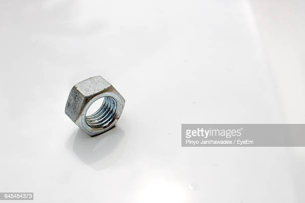 close-up of nut over white background - nut fastener stock photos and pictures
