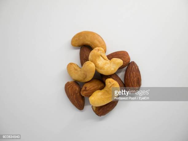 close-up of nuts against white background - cashew stock pictures, royalty-free photos & images