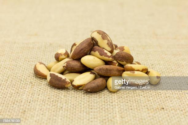 close-up of nuts - brazil nut stock photos and pictures