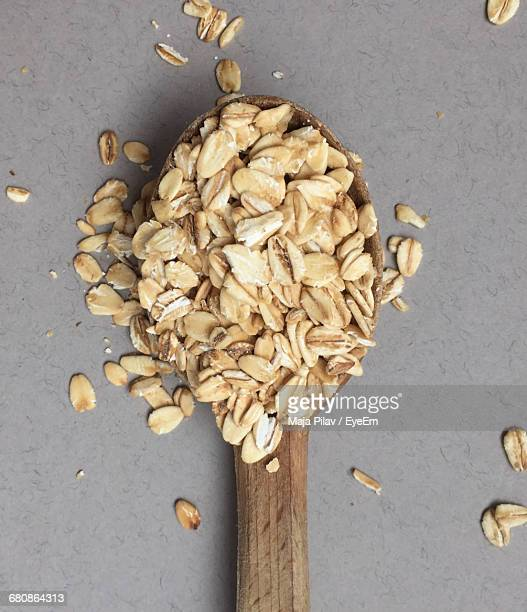 Close-up Of Oats On Spoon At Table