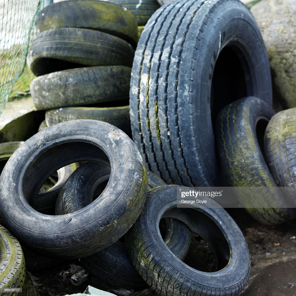 close-up of obsolete tires for recycling : Stock Photo