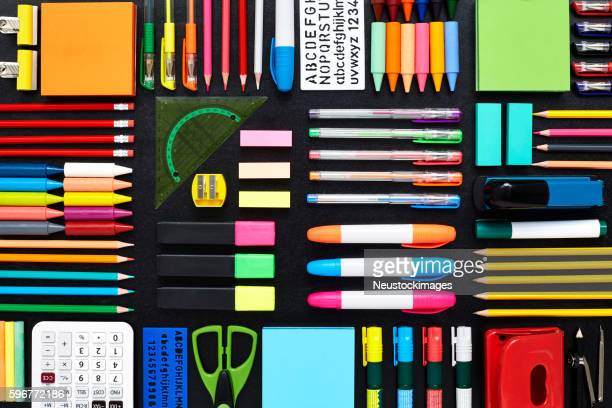 Close-up of office and school supplies are arranged on blackboar