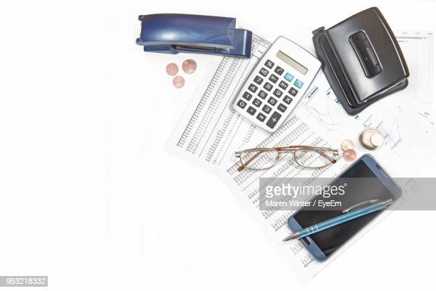 close-up of office supplies over white background - list stock pictures, royalty-free photos & images