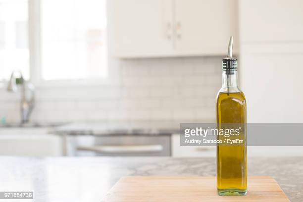 close-up of oil bottle on table - olive oil stock pictures, royalty-free photos & images