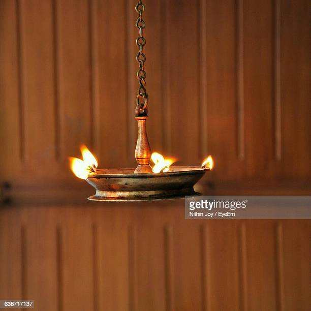 close-up of oil diya against wall - diya oil lamp stock pictures, royalty-free photos & images