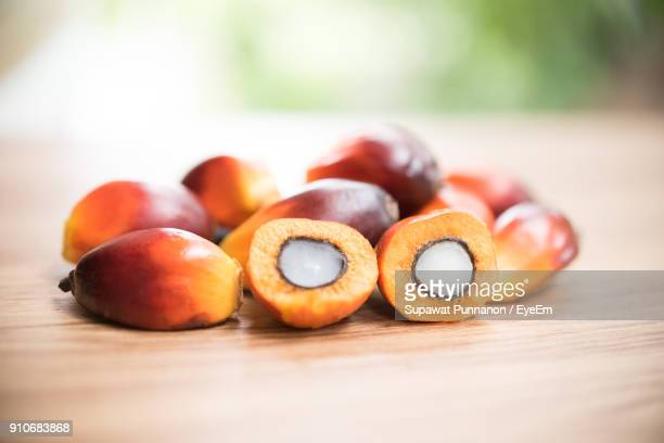 Close-Up Of Oil Palm Fruits On Table