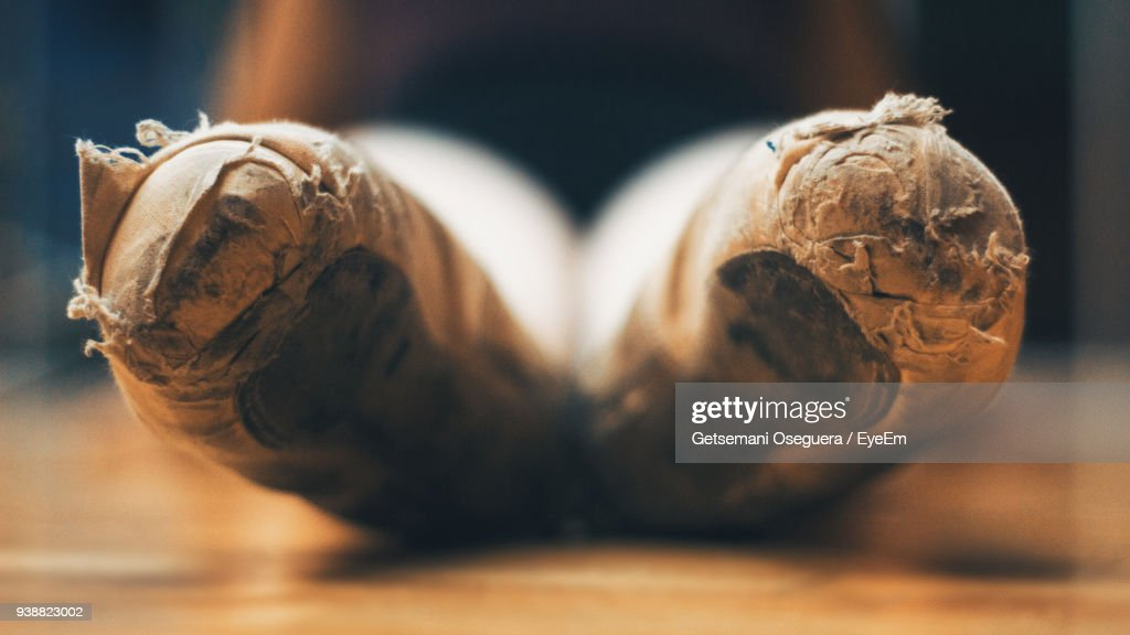 Close-Up Of Old Ballet Shoes On Table : Stock Photo