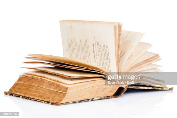 close-up of old book against white background - literature stock photos and pictures