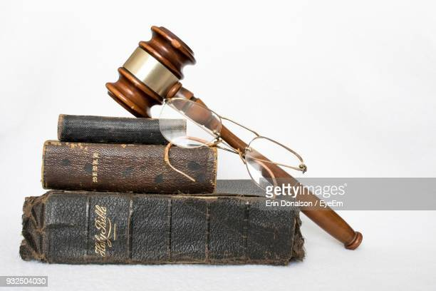 Close-Up Of Old Books And Eyeglasses On Table