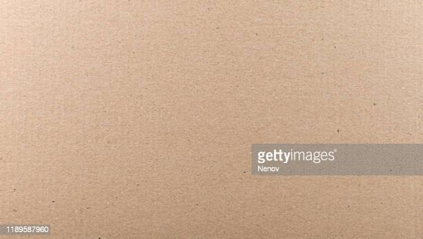 close-up of old brown paper texture background - ボール紙 ストックフォトと画像