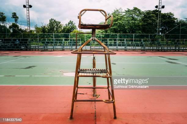 close-up of old chair for umpires on tennis court - racket sport stock pictures, royalty-free photos & images