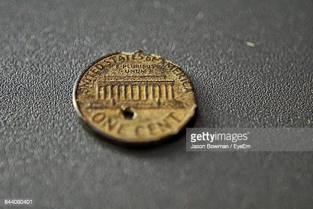 Close-Up Of Old Coin On Table