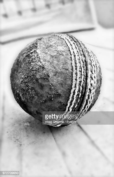 Close-Up Of Old Cricket Ball On Table