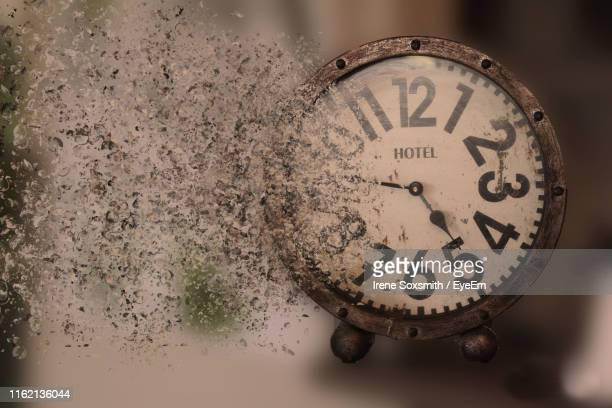 close-up of old dissolving clock - dissolving stock pictures, royalty-free photos & images
