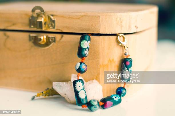 close-up of old faucet on table, wooden box - coffin stock pictures, royalty-free photos & images