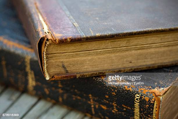 close-up of old hardcover books on table - old book stock pictures, royalty-free photos & images