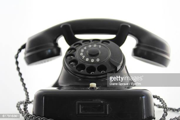Close-Up Of Old Landline Telephone Against White Background