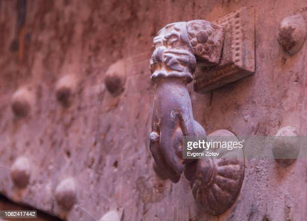 """close-up of old metallic door knocker shaped as """"hand of fatima"""". marrakesh, morocco - hamsa symbol stock photos and pictures"""