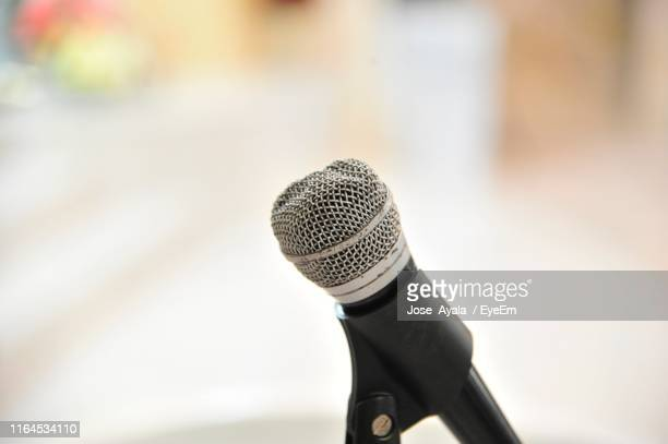 close-up of old microphone - jose ayala stock pictures, royalty-free photos & images