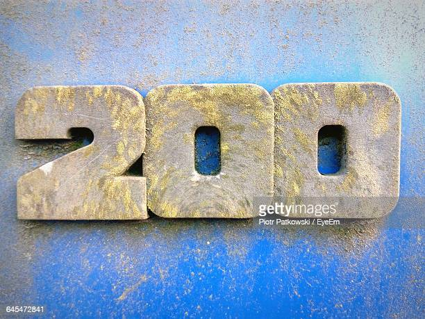 Close-Up Of Old Number 200 On Blue Wall