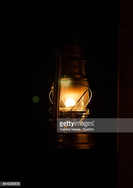 close-up of old oil lamp in darkroom - oil lamp stock pictures, royalty-free photos & images