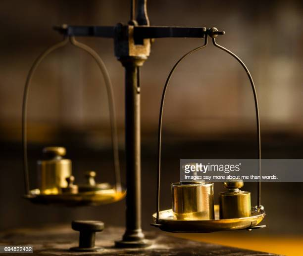 Close-up of old pharmacy scales and brass weights