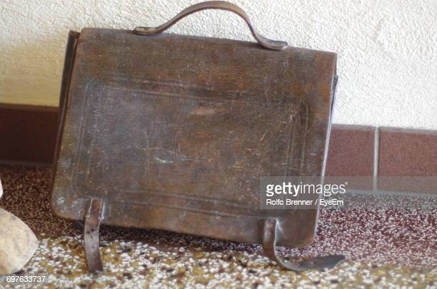 Close-Up Of Old Purse By Wall