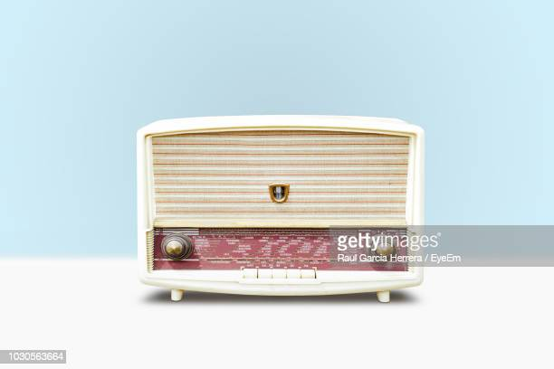 close-up of old radio against blue background - radio stock pictures, royalty-free photos & images