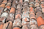 closeup old red clay roof tiles