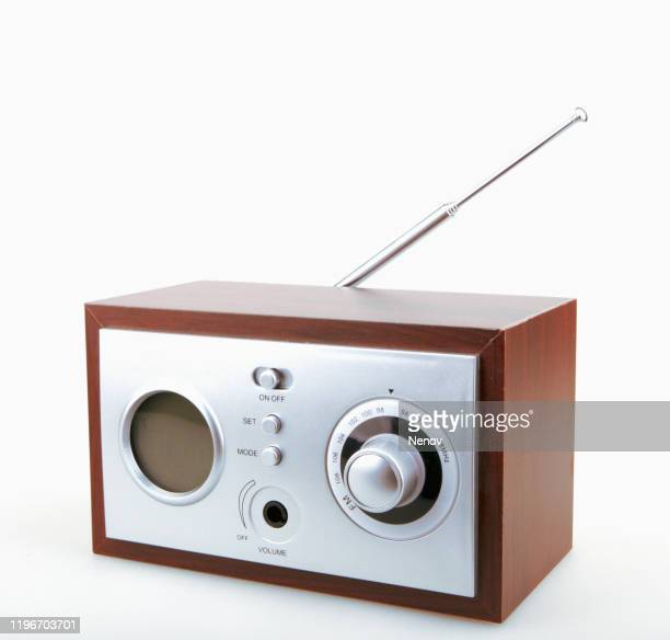 close-up of old retro radio against white background - radio stock pictures, royalty-free photos & images