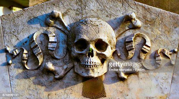 Close-Up Of Old Skull Sculpture In Cemetery