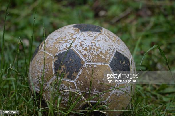 Close-Up Of Old Soccer Ball On Field