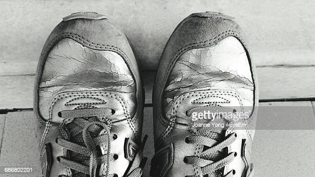 close-up of old sports shoe on floor - beaten up stock pictures, royalty-free photos & images