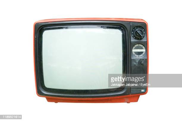 close-up of old television set over white background - retro style stock pictures, royalty-free photos & images