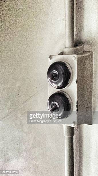 Close-Up Of Old Toggle Switch Buttons On Wall