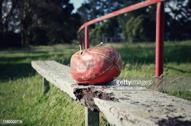 close-up of old wooden bench at a football field - afl stock pictures, royalty-free photos & images