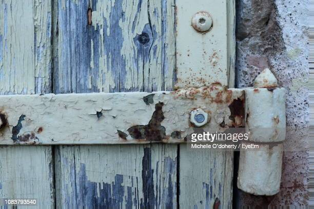 close-up of old wooden door - pezenas stock photos and pictures
