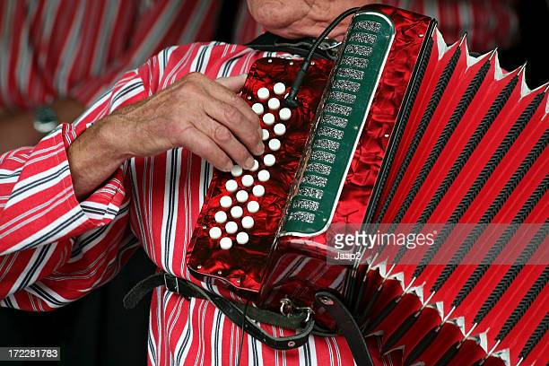 close-up of older dutch man playing a red accordion - accordion stock pictures, royalty-free photos & images