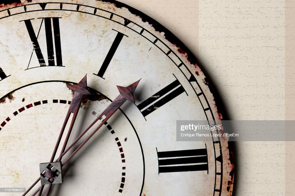 Close-Up Of Old-Fashioned Clock On Wall : Stock Photo