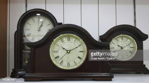 Close-Up Of Old-Fashioned Clocks On Table