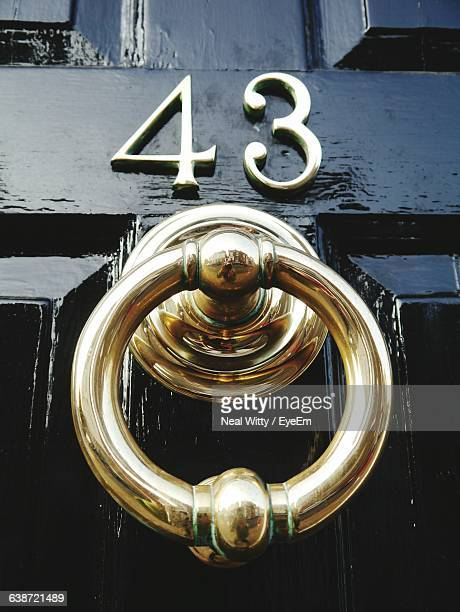 close-up of old-fashioned door knocker - door knocker stock photos and pictures