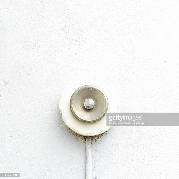close-up of old-fashioned doorbell on wall - doorbell stock pictures, royalty-free photos & images