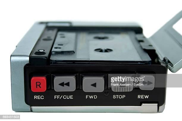 Close-Up Of Old-Fashioned Tape Recorder Over White Background