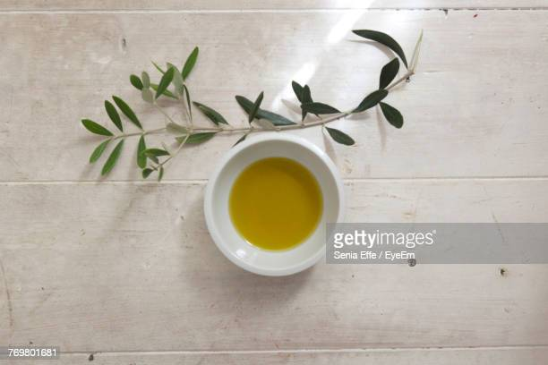 close-up of olive oil in bowl on table - olive oil stock pictures, royalty-free photos & images